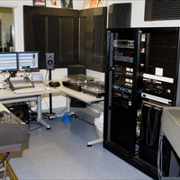 Image: audio preservation room filled with computers and other equipment such as playback systems