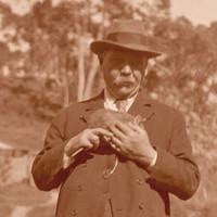 Image: Man in 1920's attire holding a possum