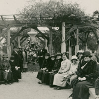 Image: group of people gathered under gazebo