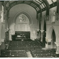 Image: Inside the Stow Memorial Church. The image shows an altar, pews and the English Gothic architectural elements of the building.