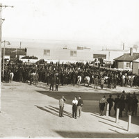 Image: men and horses gathered in a crowd for a strike