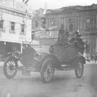 Image: A group of people in a car travelling along a street