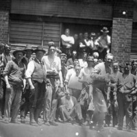 Image: a group of men gathered outside an abattoir