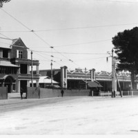 Image: An image of the State Herbarium in the early 1900s. Tram lines are shown running to the building and to the right is the Goodman administration building
