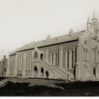 Image: This image shows the Wesleyan Church in 1925. The black and white image shows the church's front and side view, with a group of bicycles leaning up against the side of the building and a 1920s era car in the distance.