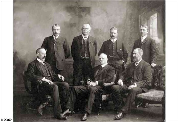 Image: Group portrait of men in suits