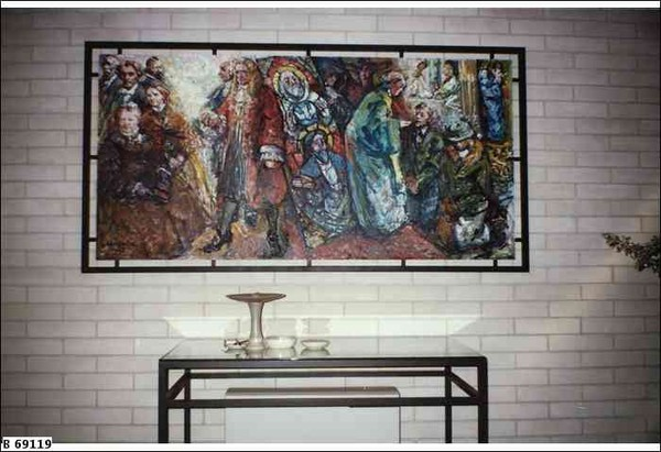 Image: painting of religious figures hangs on a white brick wall behind an altar