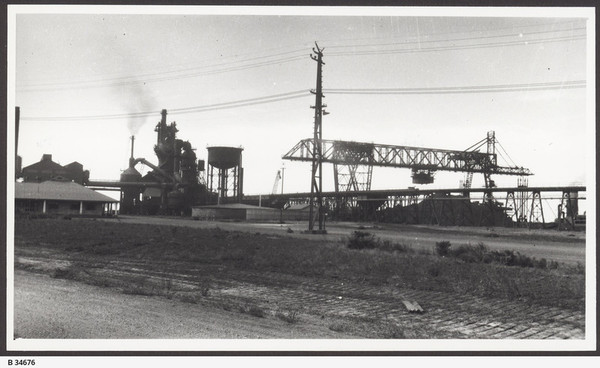 Image: Building next to large steel machinery