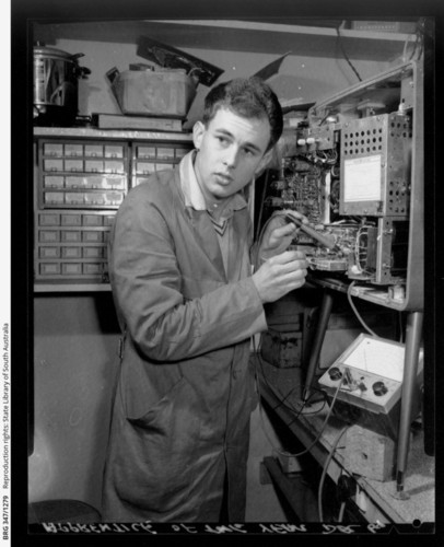 Image: Young man operating machinery