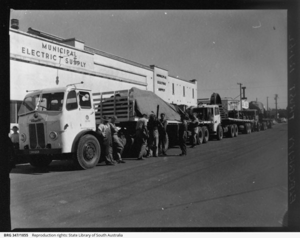 Image: large truck in front of stone building