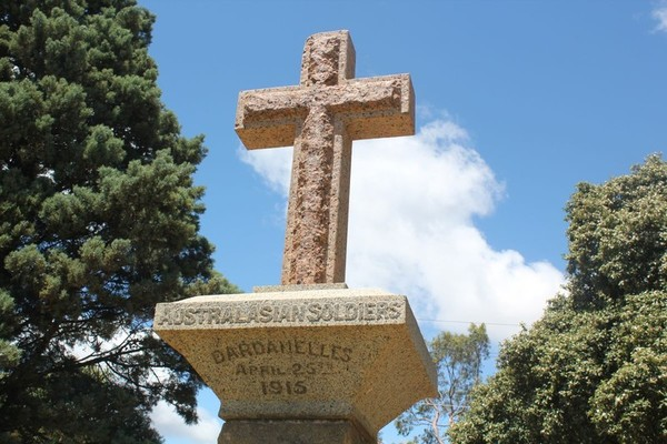 Image: stone cross in park land