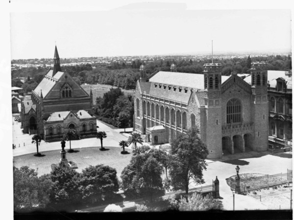 Image: A black and white aerial photograph shows two large stone halls surrounded by gardens