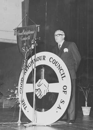 Image: man giving speach at podium
