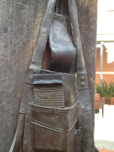 Image: bronze sculpture of pad in an apron pocket