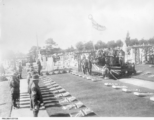 Image: soldiers conducting a funeral service in 1923. In black and white.