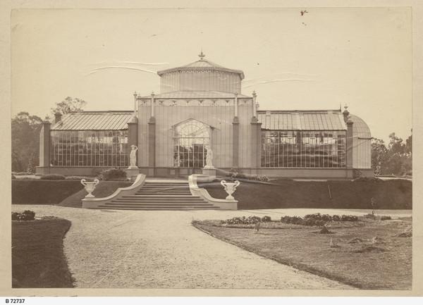 Image: Sepia photograph of glasshouse on raised earthen platform