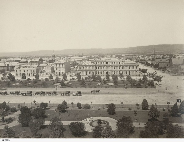 Image: View of large public square from above, featuring many horses and carriages