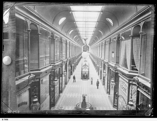 image: interior of an ornate 19th century shopping arcade