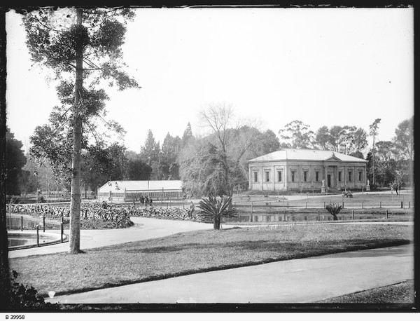 Image: grass and pond with Greek Revival style building in the background