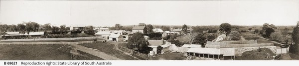 Panoramic view of the Anlaby homestead and surrounding structures and gardens. Two men are transferring hay from a horse drawn cart