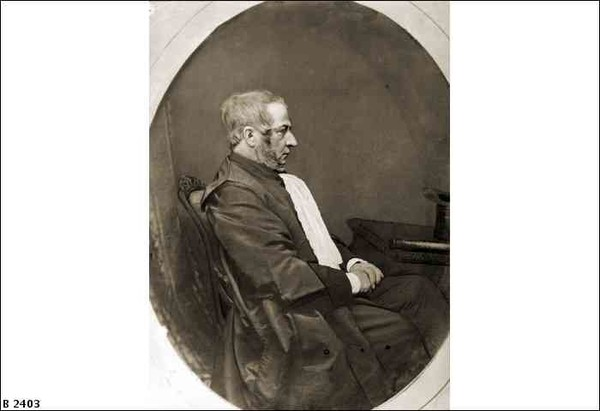 Image: Photograph of seated man in profile.