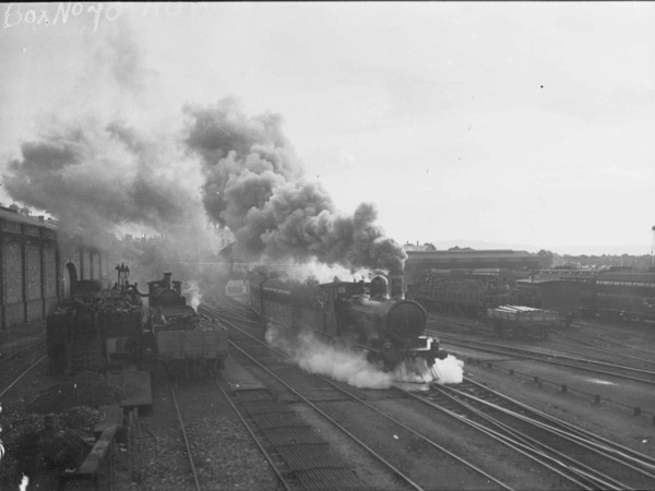 Image: steam train with large cloud of smoke