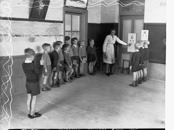 Image: Nurse conducting eye test