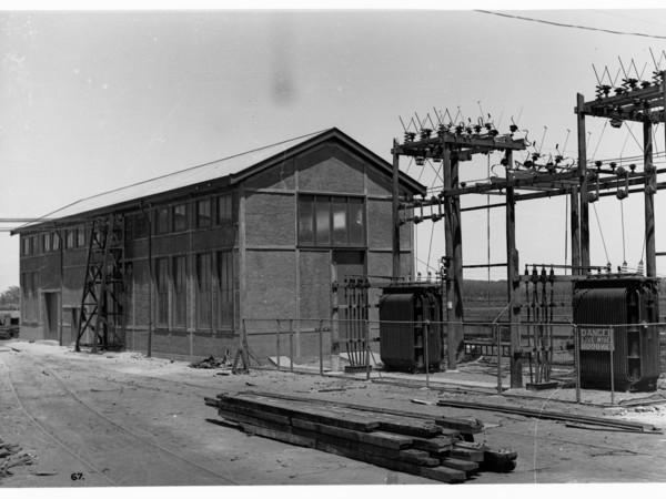 Image : Building with wooden power poles and transformers