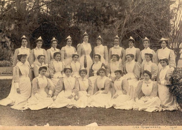 Image: A black and white image of Margaret Graham surrounded by other nurses