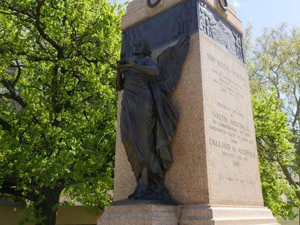 Image: Bronze female angel atop granite pillar