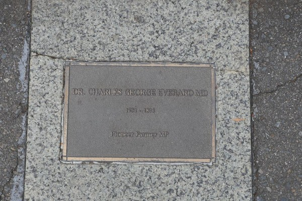 Bronze plaque set in pavement, inscribed with information about Dr Charles George Everard