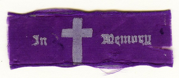 Image: purple ribbon with white cross and text: in memory
