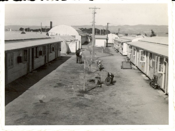Image: rows of curved tin buildings