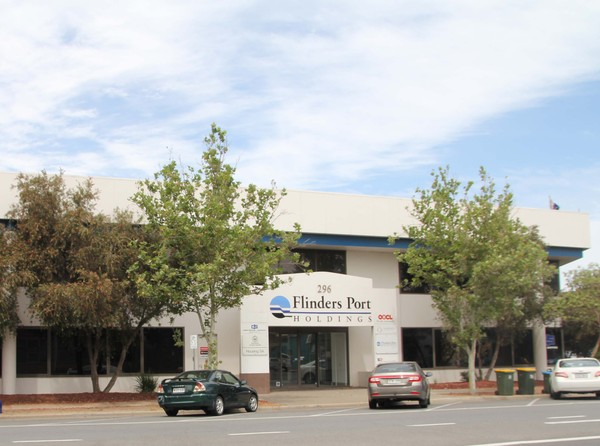 Large concrete and glass building with sign, Flinders Ports