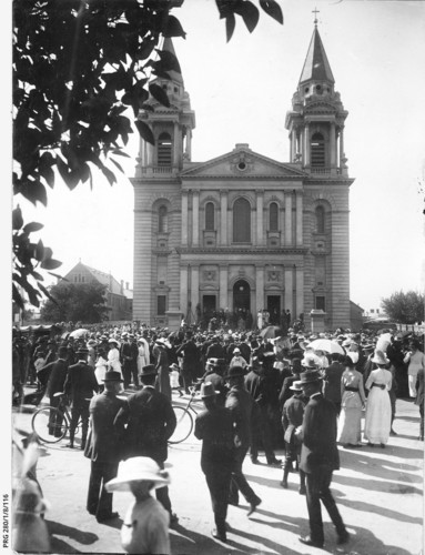 Image: a crowd of people standing outside a church