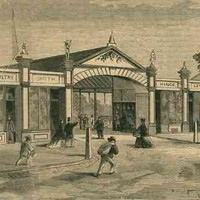 Image: A drawing of a row of mid-19th century shops with women and men, one on a horse, heading towards them. The shops include a draper, a smith, a butcher and others.
