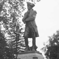 Image: sculpture of standing man in nineteenth century costume