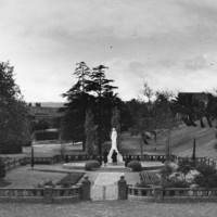 Image: walled garden with stone statue in middle