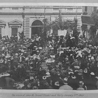 Image: crowd of people in front of stone building