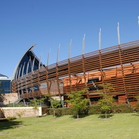 Image: Large curved building front clad in wooden slats