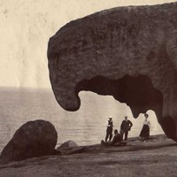 Image: people in front of large rock formation