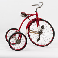 Image: Red metal bike with three wheels