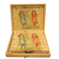 Image: box of sepia toned blocks showing pictures of little girls