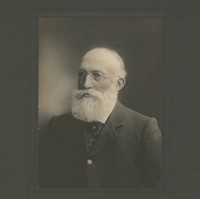 Image: A photographic portrait of an elderly man with a full, white beard and wire-rimmed glasses