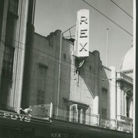Image: Facade of building with prominent sign declaring Rex Theatre