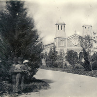 Image: View of a group of children in garden with church in the background