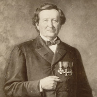Image: A painted portrait of a middle-aged Caucasian man wearing a mid-19th century coat and bowtie. Three medals are pinned to the left breast of his coat