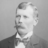 Image: Black and white photograph of young man with a moustache