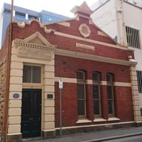 Image: brick building with peaked front