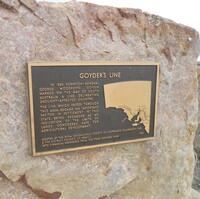 Image: bronze plaque on large stone